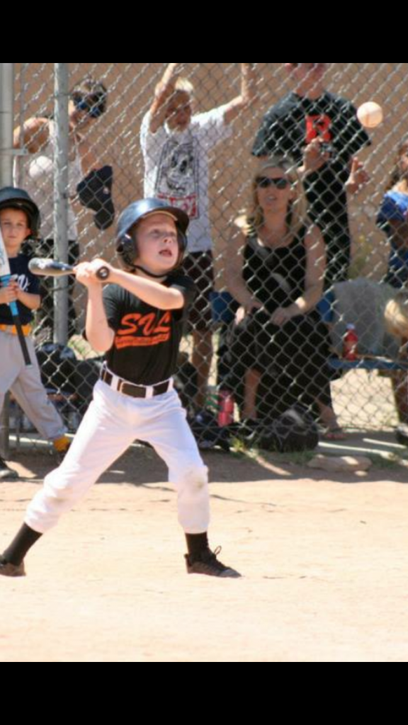 Look at my son trying to hit this pitch by a well meaning volunteer dad.  This isn't helping him become a good hitter.  No way.